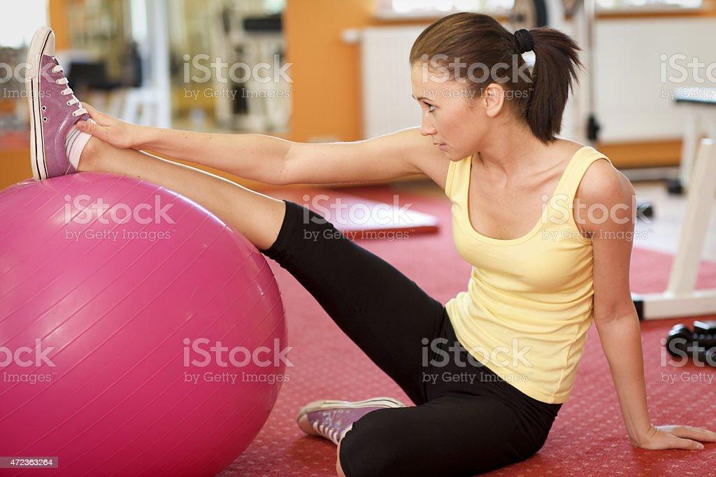 Woman Balancing On Swiss Ball stock photo