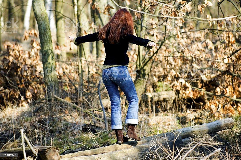 Woman balancing on the stump royalty-free stock photo