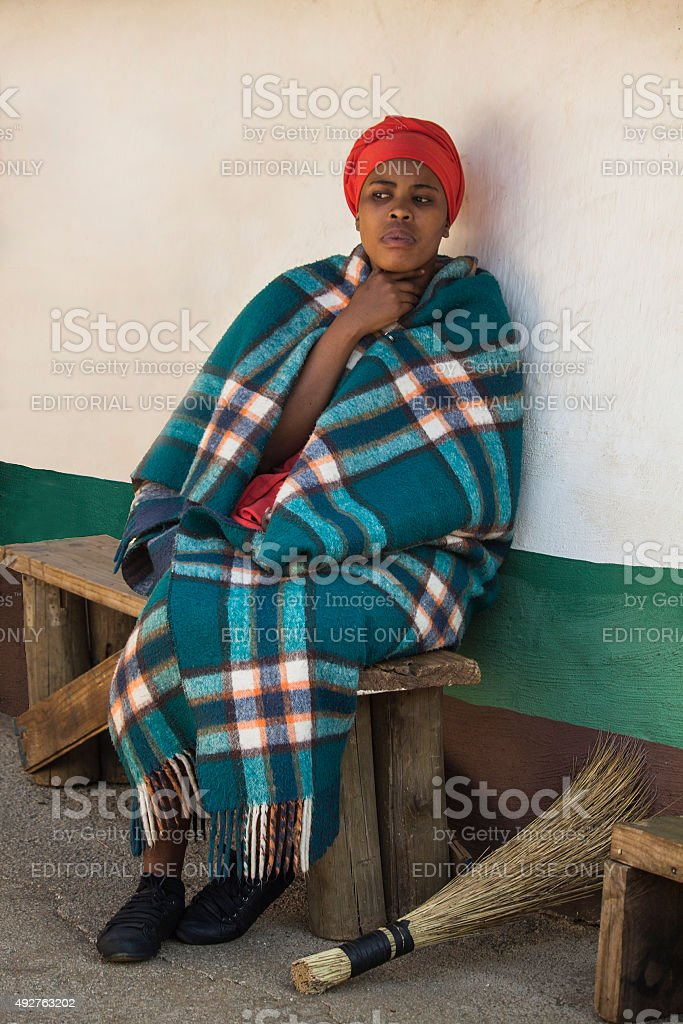 Woman Bantu nation in ethnic clothes next to her house. stock photo