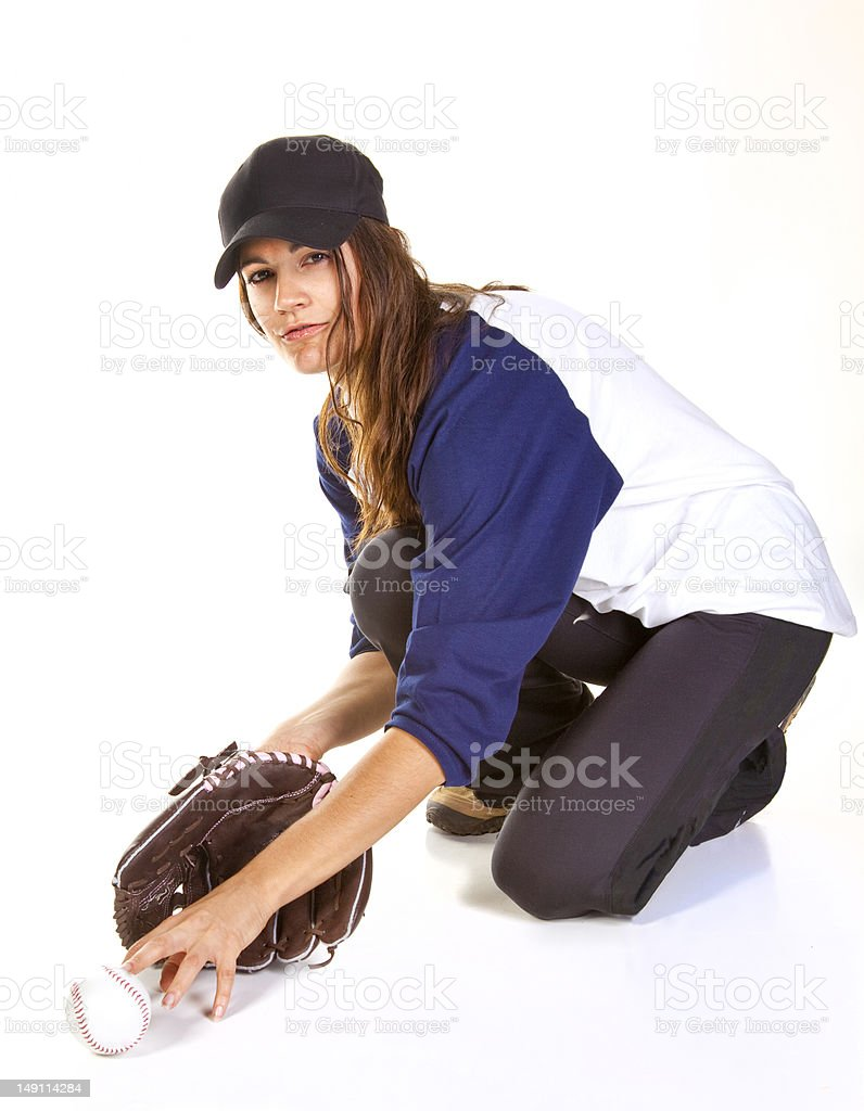 Woman Baseball or Softball Player Catches a Ball stock photo