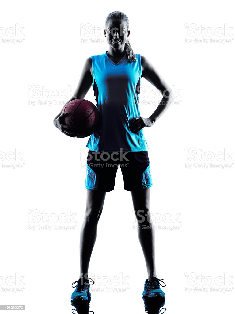 woman basketball player silhouette stock photo