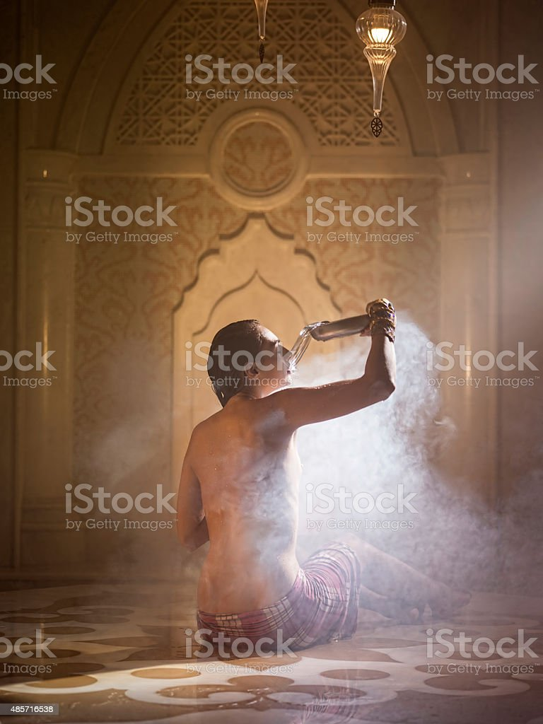 Woman bathed in turkish bath stock photo