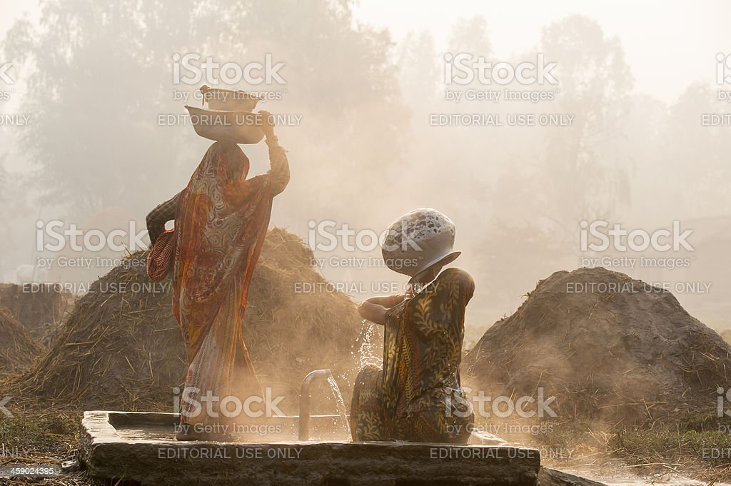 woman bathing at well in village close to Janakpur, Nepal stock photo