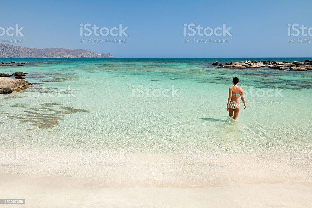 Woman bathing in Elafonisi beach stock photo