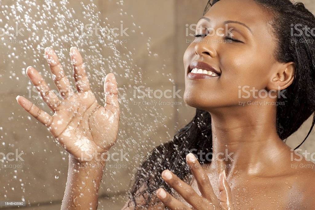 Woman bathing under the  shower. royalty-free stock photo