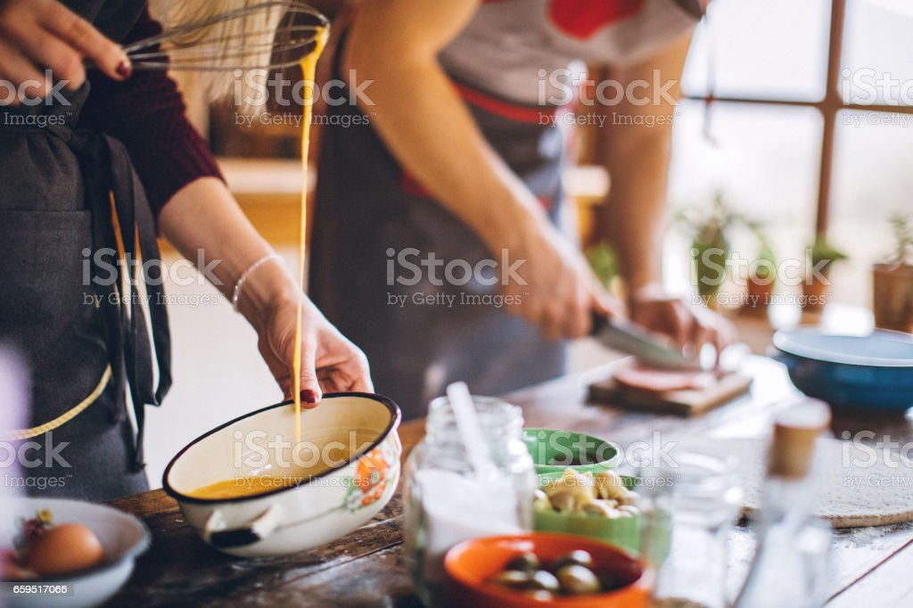Woman beating eggs with whisk stock photo
