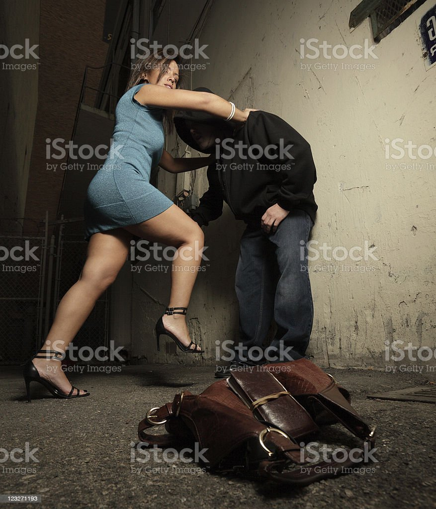 Woman beating the attacker royalty-free stock photo