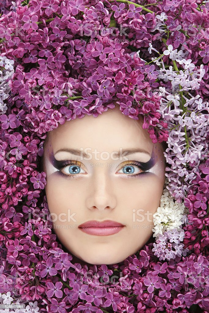 woman beautiful face with flower lilac border royalty-free stock photo