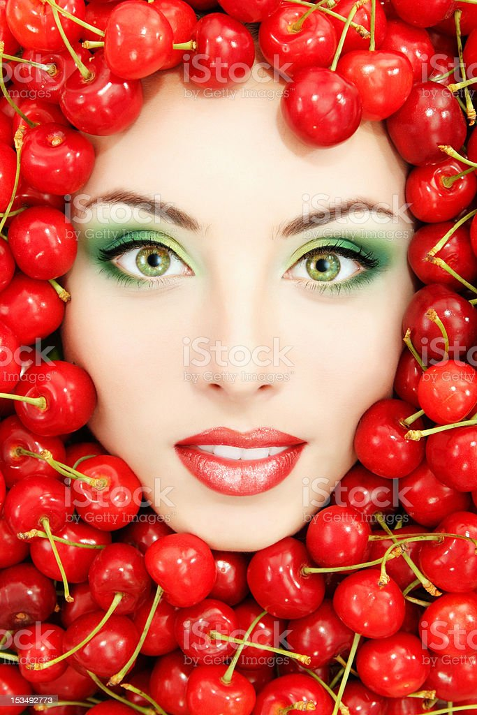 woman beautiful face with red ripe fresh cherry royalty-free stock photo