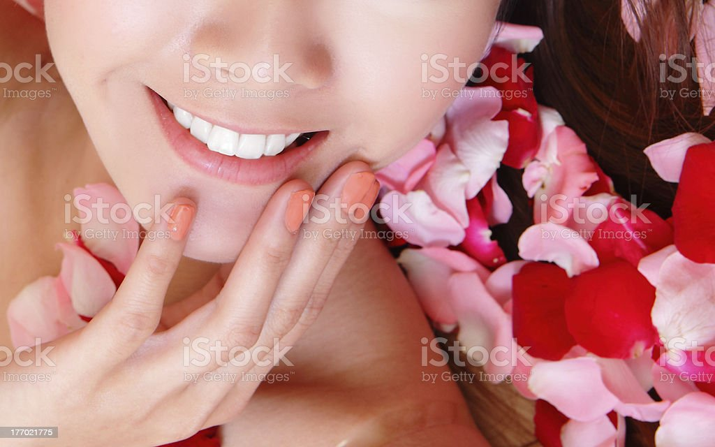 woman beautiful lips with pink and red roses royalty-free stock photo