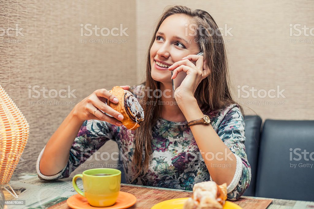 Woman beautiful model in the coffee shop with pastries stock photo