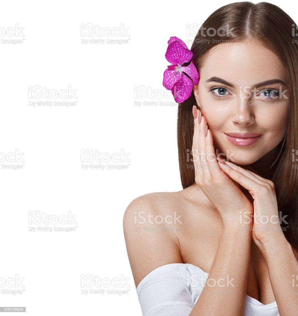 Woman beautiful portrait with flower orchid in hair isolated white stock photo