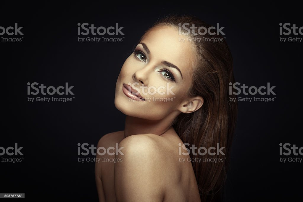 Woman beauty portrait on dark background stock photo