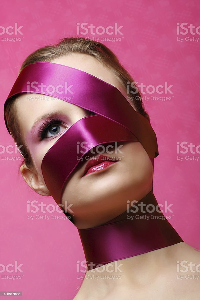 woman beauty portrait with wrapped ribbon royalty-free stock photo