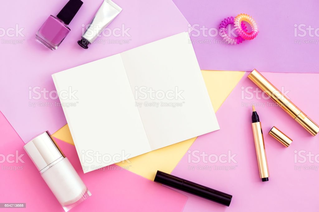 Woman beauty products and blank notepad top view. stock photo