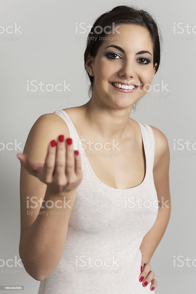 Woman beckoning to the viewer royalty-free stock photo