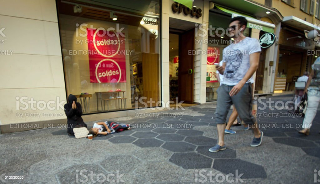 Woman begging with child stock photo