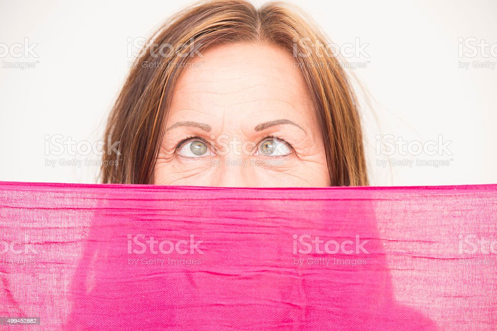 Woman behind cloth crossed-eyed stock photo