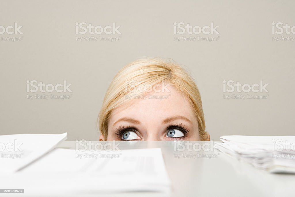 Woman behind filing cabinet stock photo