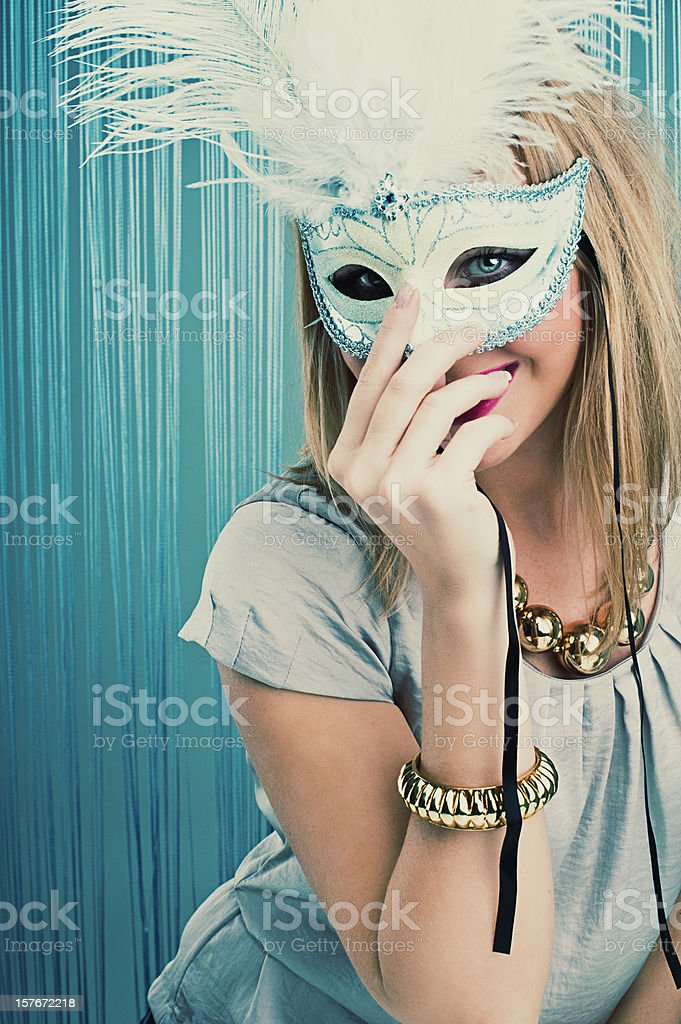 woman behind mask stock photo