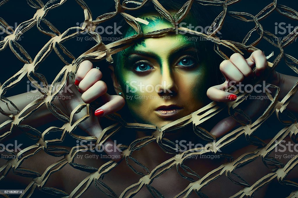 Woman behind net stock photo