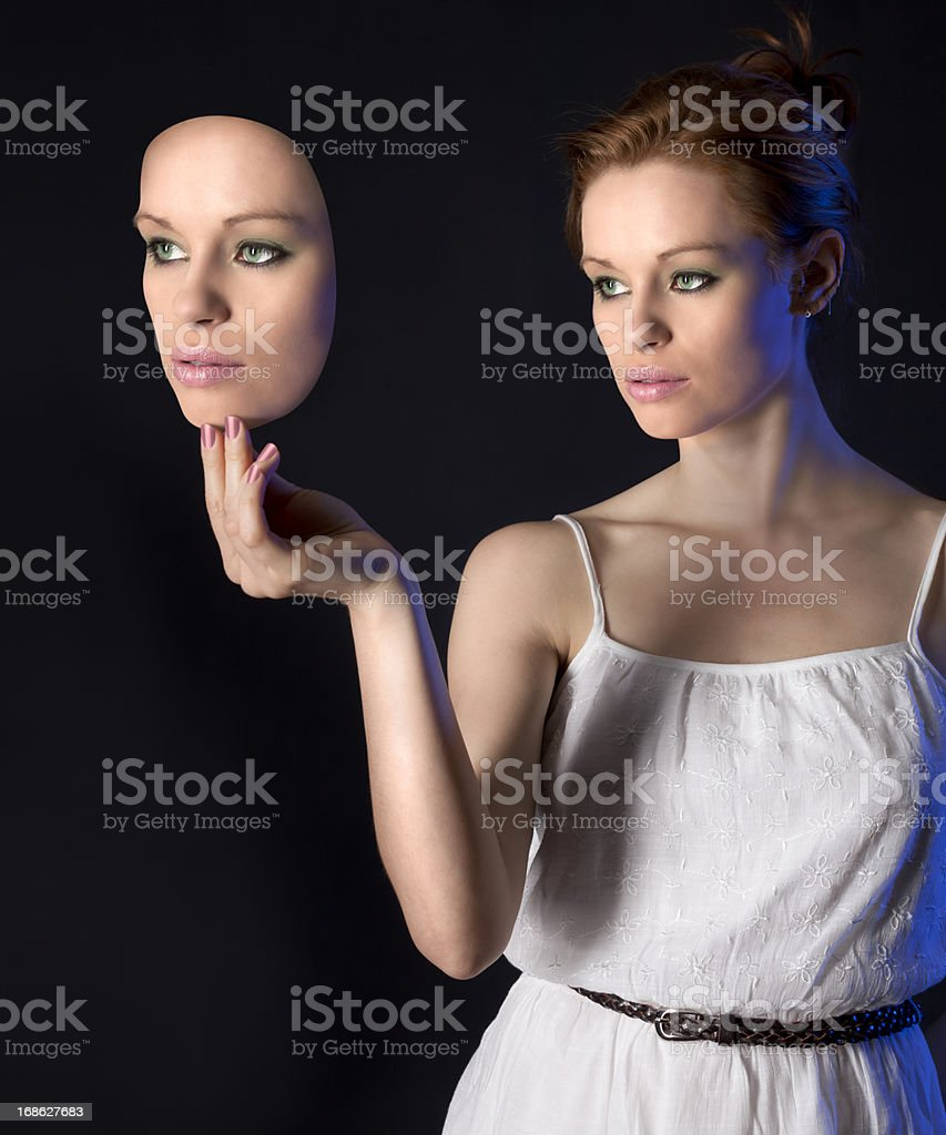 Woman Behind the Mask stock photo