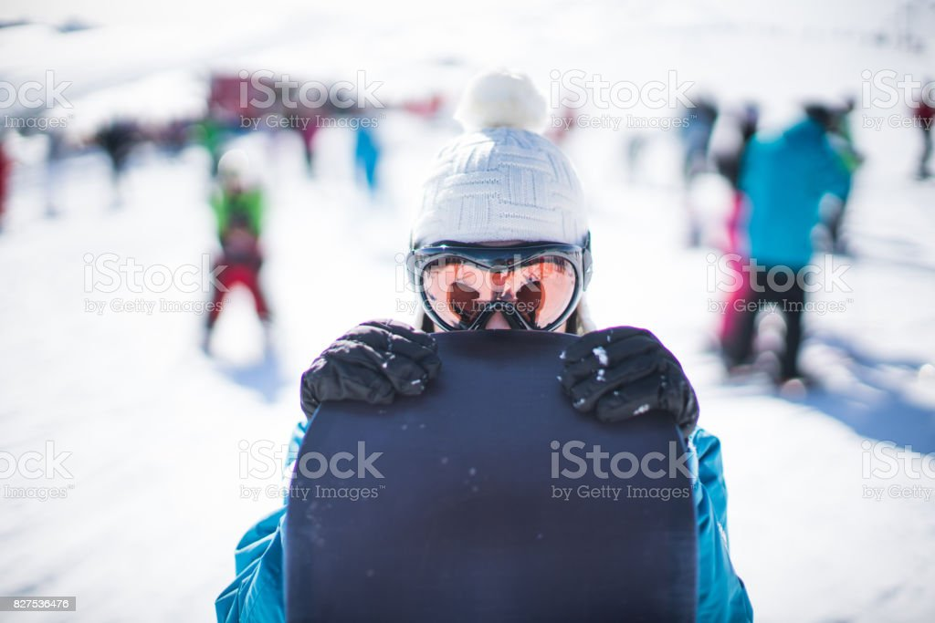 Woman behind the snowboard stock photo
