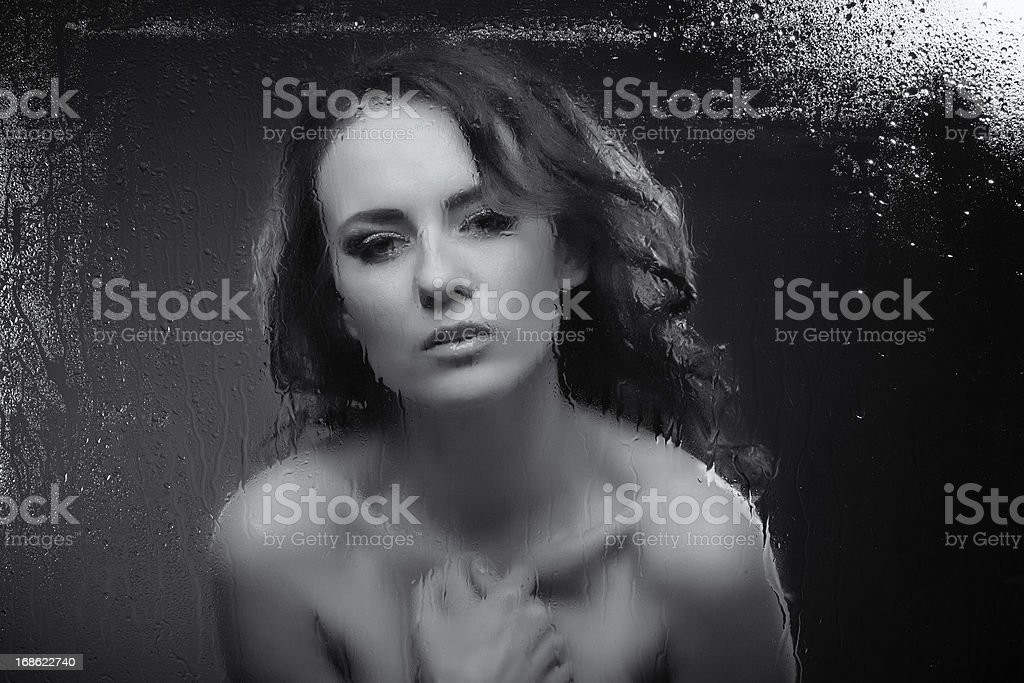 woman behind wet window royalty-free stock photo
