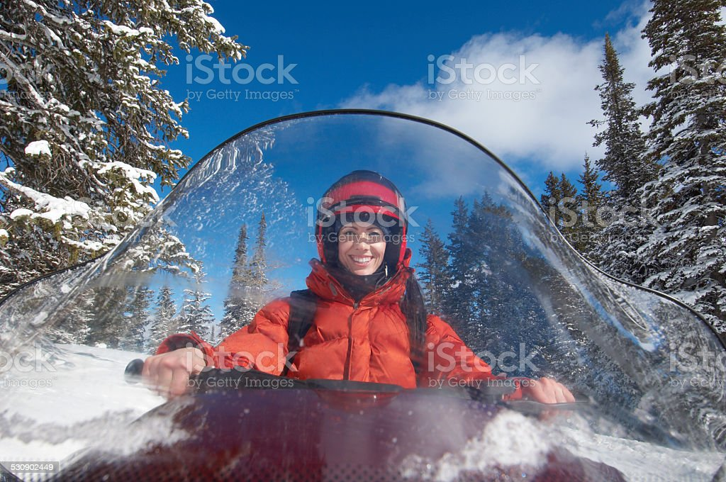 Woman Behind Windshield of Snowmobile stock photo