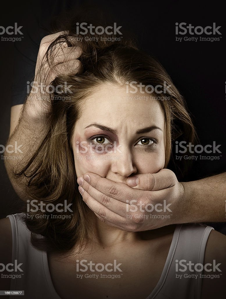 woman being abused and strangled by strong man royalty-free stock photo