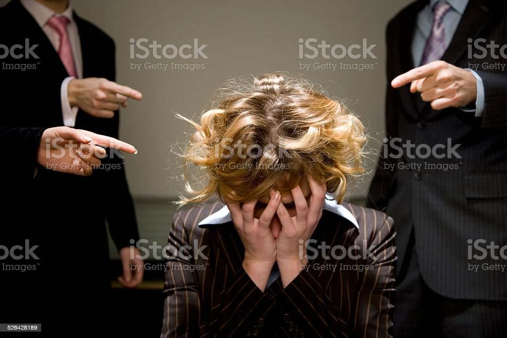 Woman Being Accused in Office stock photo