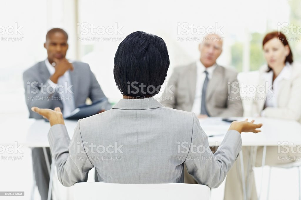 Woman being interviewed by a panel of interviewer royalty-free stock photo