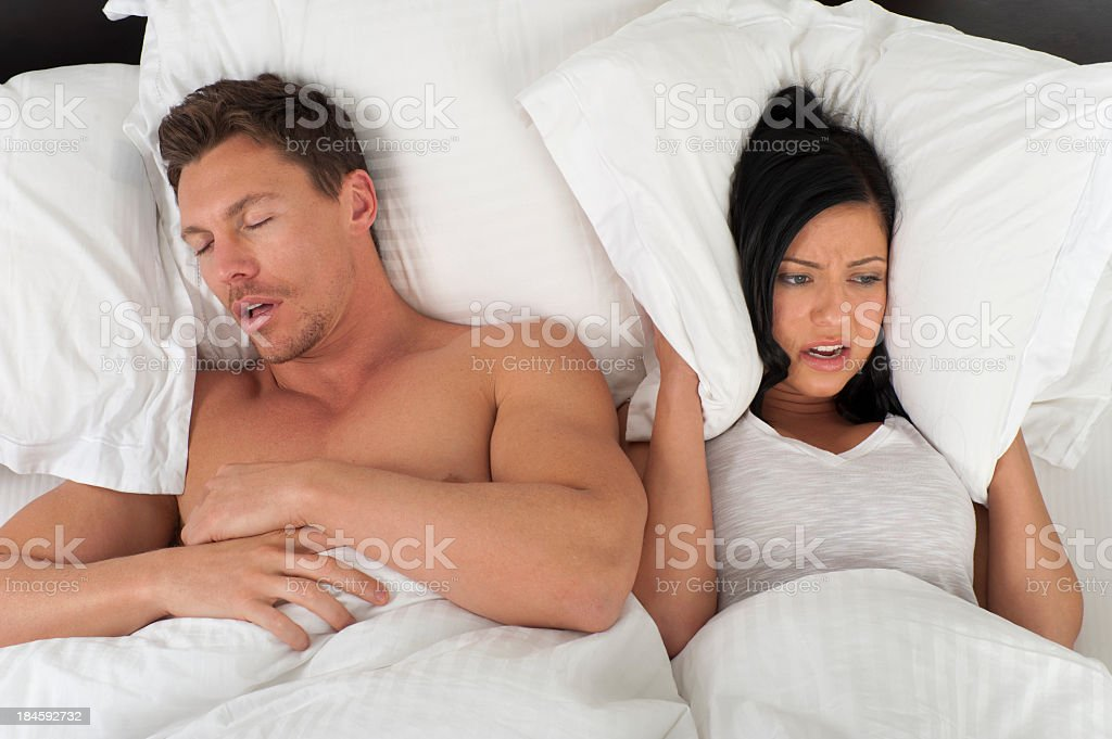 Woman being kept awake by snoring royalty-free stock photo
