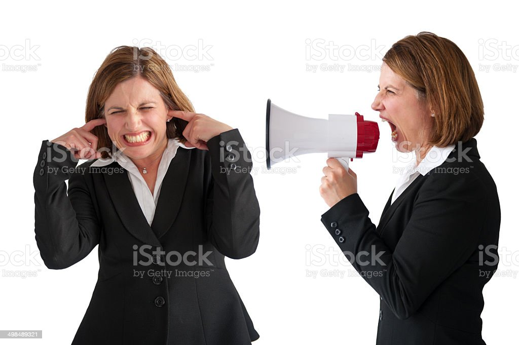 woman being yelled at by female manager stock photo