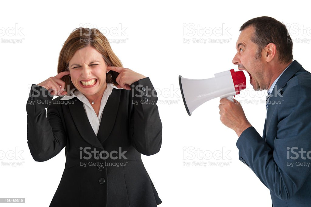 woman being yelled at by manager stock photo