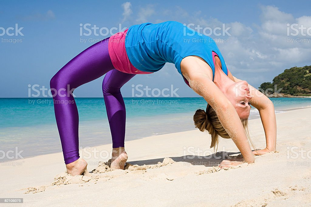 A woman bending over backwards stock photo