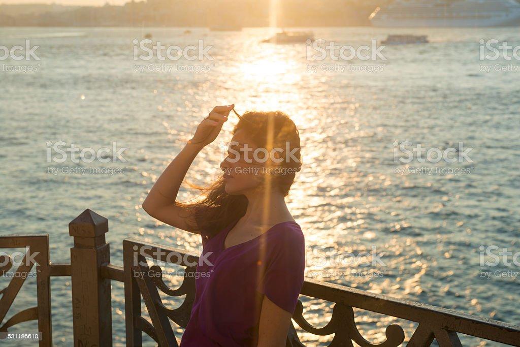 Woman beside Bosphorus Strait in Istanbul, Turkey stock photo