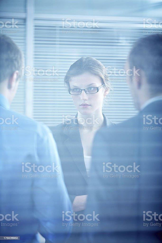 Woman between men royalty-free stock photo