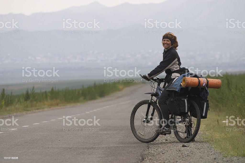 Woman biker on a road royalty-free stock photo