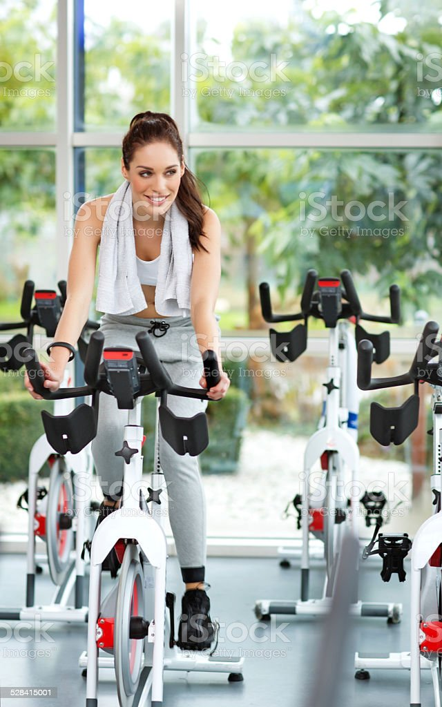 woman biking indoors stock photo