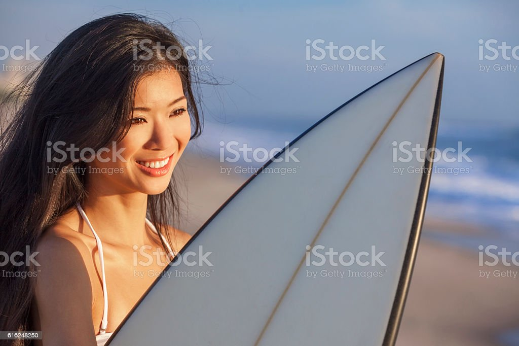 Woman Bikini Surfer & Surfboard Sunset Sunrise Beach stock photo