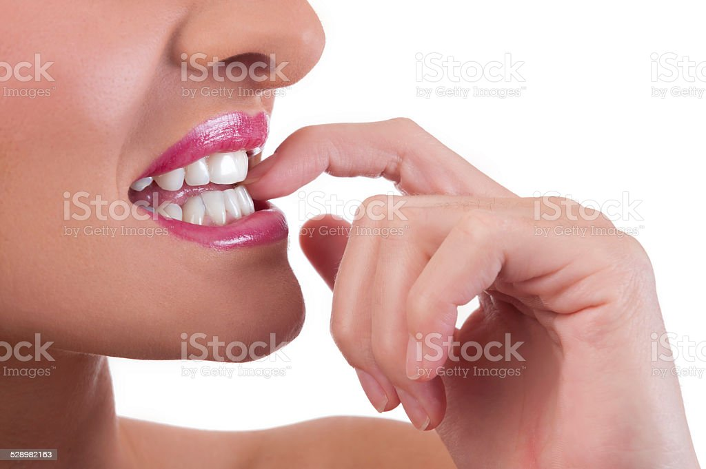 Woman bites her nails stock photo