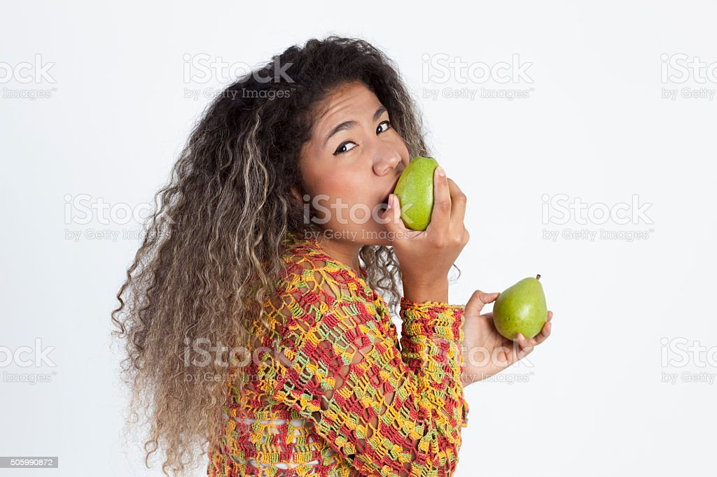 Woman biting a pear stock photo