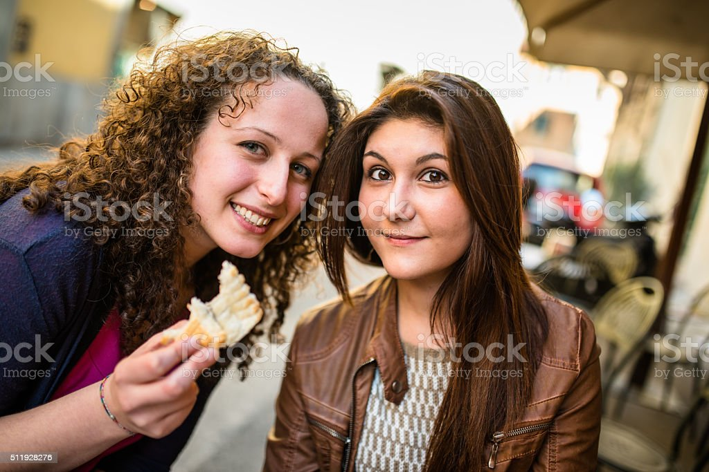 woman biting a snack at the cafe stock photo