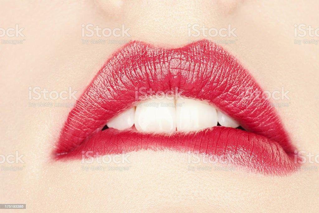 Woman biting her lip royalty-free stock photo
