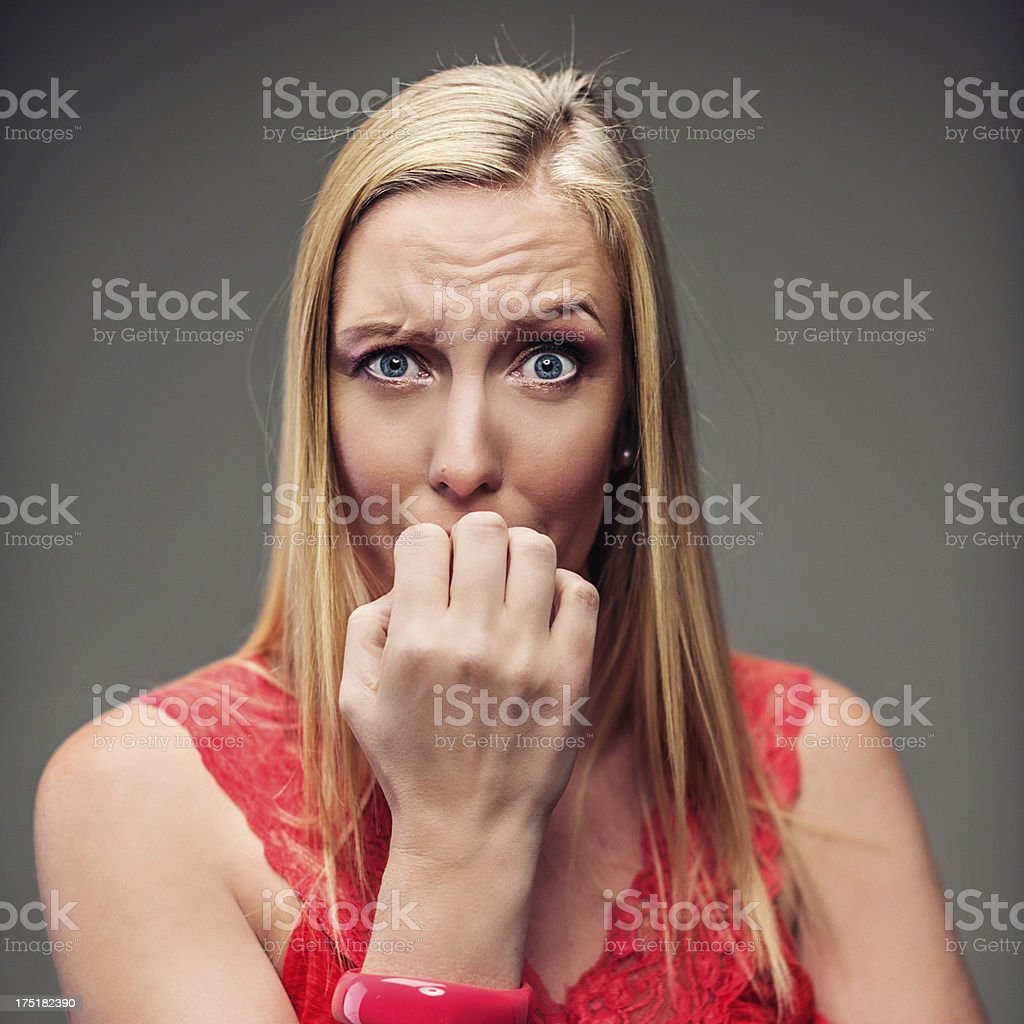 Woman biting her nails royalty-free stock photo