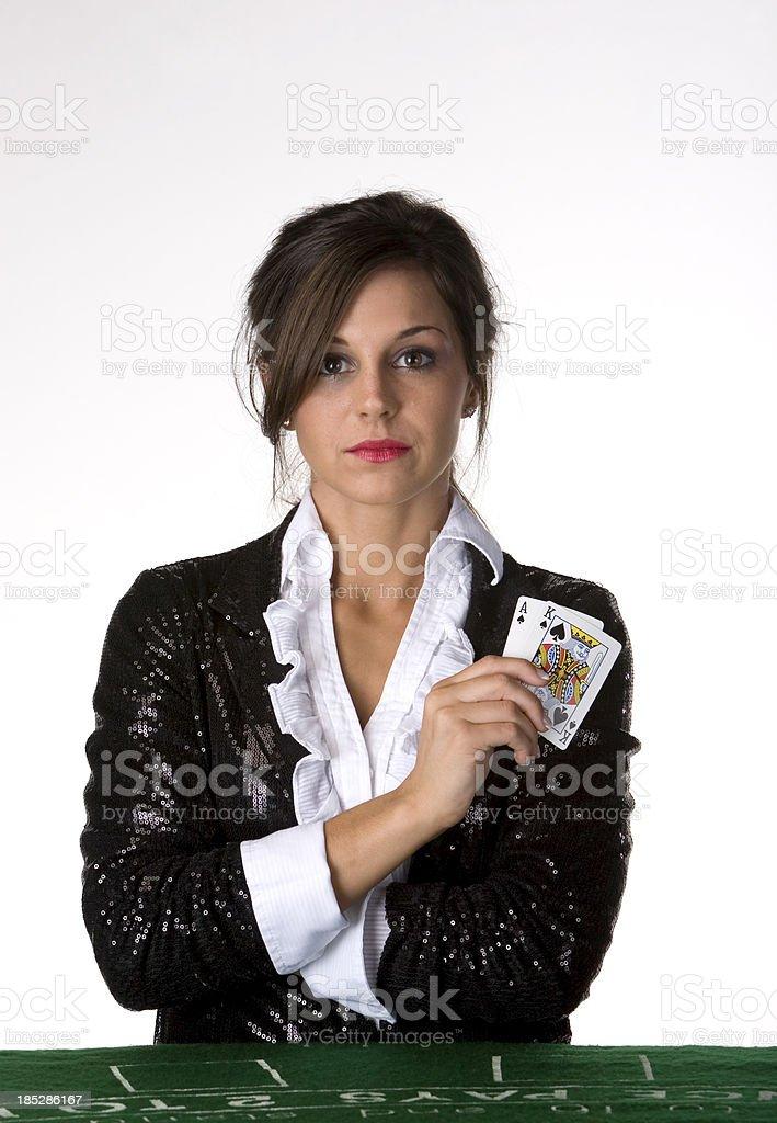 Woman blackjack dealer stock photo