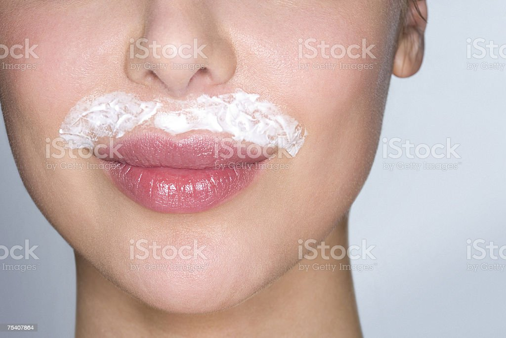 Woman bleaching facial hair stock photo