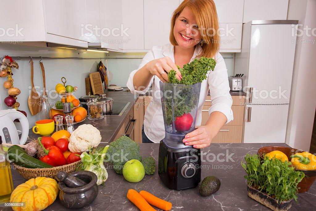 Woman blending vegetables stock photo
