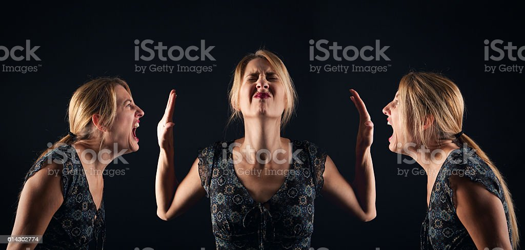 Woman Blocking Her Angry Voices Out stock photo